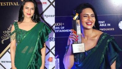 Divyanka Tripathi stuns in beautiful green saree and poses with the award
